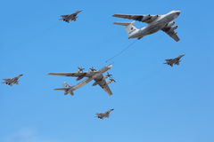 Il-76 and Tu-95ms planes accompanied by fighters Stock Photography