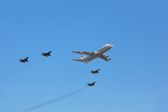 Il-80 plane accompanied by fighters Mig-29 Royalty Free Stock Images