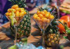 Il als nano dell'arancia conosciuto come i kumquat è servito in un vetro Fotografia Stock Libera da Diritti
