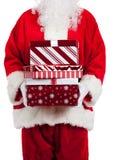 Il Babbo Natale che dà i regali di Natale Immagini Stock Libere da Diritti