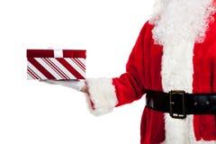 Il Babbo Natale che dà i regali di Natale Immagine Stock Libera da Diritti