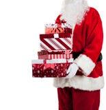Il Babbo Natale che dà i regali di Natale Fotografie Stock Libere da Diritti