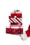 Il Babbo Natale che dà i regali di Natale Fotografia Stock