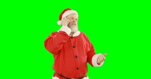 Il Babbo Natale che parla sul telefono cellulare video d archivio