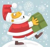 Il Babbo Natale che porta presente Immagine Stock Libera da Diritti