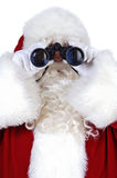 Il Babbo Natale con il binocolo immagine stock