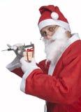 Il Babbo Natale con il regalo del ittle Fotografia Stock