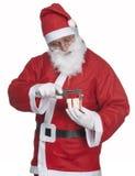 Il Babbo Natale con il regalo del ittle Immagini Stock Libere da Diritti