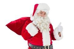 Il Babbo Natale con il suoi sacco e pollici su Fotografia Stock Libera da Diritti