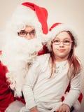 Il Babbo Natale con la bambina Fotografie Stock