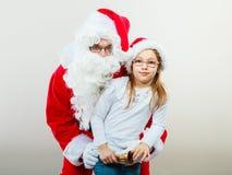 Il Babbo Natale con la bambina Fotografia Stock Libera da Diritti