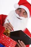 Il Babbo Natale con la lista Immagini Stock Libere da Diritti