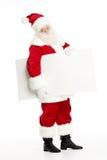 Il Babbo Natale con la scheda bianca Fotografia Stock Libera da Diritti