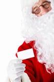Il Babbo Natale con un biglietto da visita Fotografia Stock Libera da Diritti