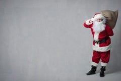 Il Babbo Natale con un sacchetto pieno dei presente Fotografia Stock