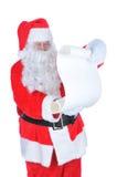 Il Babbo Natale con una lista impertinente in bianco Fotografie Stock Libere da Diritti