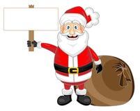 Il Babbo Natale di sguardo felice sveglio che tiene un bl di legno Immagine Stock