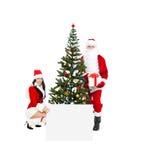 Il Babbo Natale e Santa Giirl Fotografia Stock Libera da Diritti