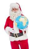 Il Babbo Natale felice che tiene un globo Fotografia Stock