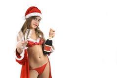 Il Babbo Natale sexy Noel con due di vetro e champagne Immagine Stock