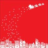 Il Babbo Natale sopra la città Fotografia Stock