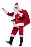 Il Babbo Natale sta augurandogli il Buon Natale Fotografia Stock Libera da Diritti