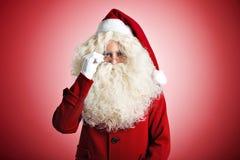 Il Babbo Natale su priorità bassa rossa Fotografia Stock