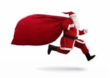 Il Babbo Natale sull'esecuzione immagini stock