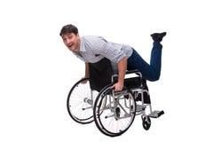 Il badante con la sedia a rotelle isolata su bianco Fotografia Stock
