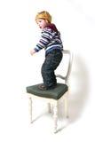 Il bambino è la sporgenza Fotografie Stock
