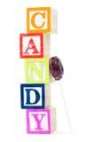 Il bambino blocca la caramella di ortografia Fotografia Stock