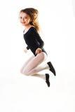 Il bambino che salta per la gioia Immagini Stock