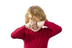 Il bambino che sfrega il suo osserva immagini stock