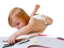 Il bambino con l'album e morbido-capovolge la penna Immagine Stock