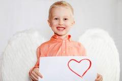 Il bambino con le ali di un angelo Fotografie Stock