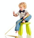 Il bambino con lle roulette Fotografie Stock Libere da Diritti