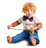 Il bambino con lle roulette Fotografia Stock