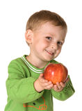 Il bambino con una mela Fotografie Stock Libere da Diritti