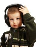 Il bambino in cuffie fotografia stock libera da diritti