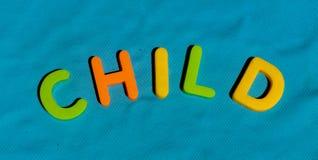 Il bambino di parola scritto dalle lettere del giocattolo Fotografia Stock Libera da Diritti