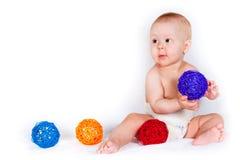 Il bambino di seduta con i giocattoli Fotografia Stock Libera da Diritti