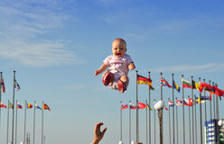 Il bambino durante il volo Fotografia Stock