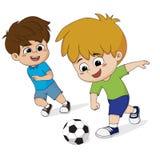 Il bambino gioca a calcio con gli amici Fotografia Stock Libera da Diritti