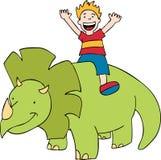 Il bambino guida un dinosauro Fotografia Stock