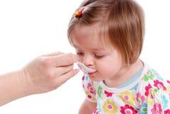 Il bambino mangia Fotografie Stock