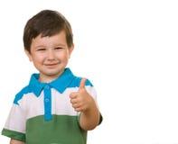 Il bambino mostra il segno dell'APPROVAZIONE Immagine Stock