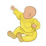 Il bambino nella seduta gialla dei pigiami Immagini Stock