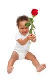 Il bambino nero che presenta il fiore è aumentato immagini stock