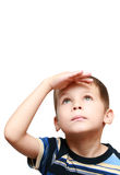 Il bambino osserva in su Immagine Stock
