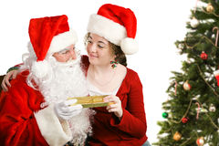 Il bambino ottiene il regalo di Natale da Santa immagine stock libera da diritti